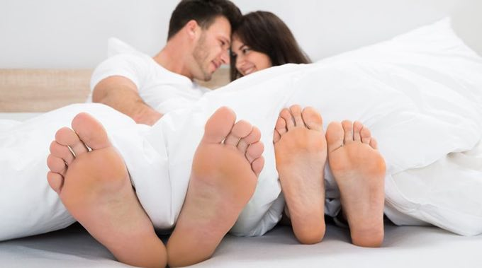 couple in bed with feet