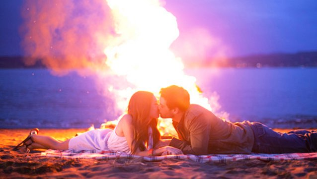 couple kissing fire
