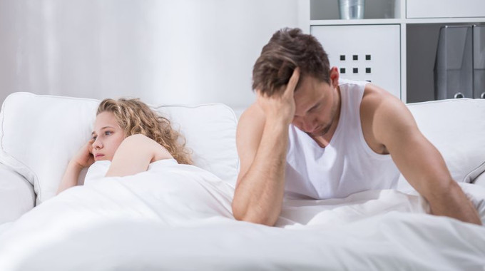 Upset couple in bed