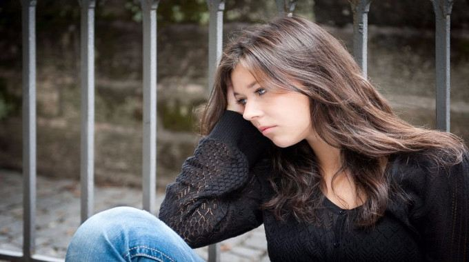 Young lady looking depressed-compressed