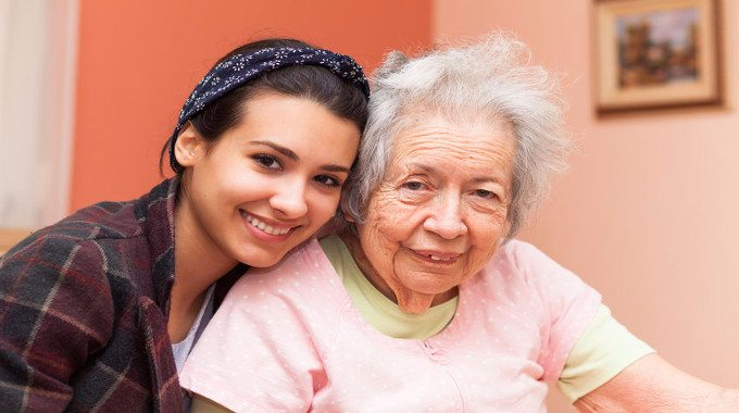 Elderly 80 plus year old grandmother with granddaughter-compressed