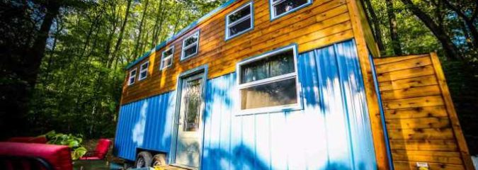 This Must-See Tiny House Has a Lower Level Master Bedroom and a Table That Doubles As Art